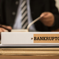Attorney reviewiing a bankruptcy file.jpg.crdownload