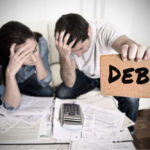 couple struggling with debt