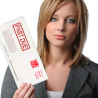 Woman bill collector holding up overdue bills envelope