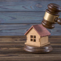 Legal ruling on property fees concept - gavel on house