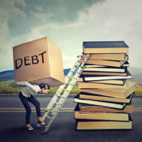 Student loan debt concept - Woman with heavy box debt carrying it up education ladder
