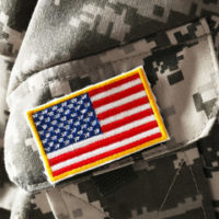 military service member's jacket with US flag patch