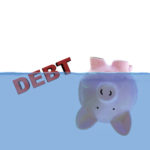 Piggy bank submerged under water to indicate discharge of debt