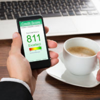 Businessman Checking Credit Score On Cellphone app