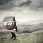 Businesswoman brings rock with Debt word